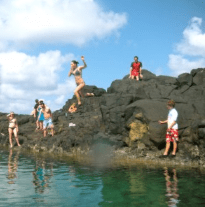 "Me jumping off a rock in Hawaii.  #Tag: Getting to Know the ""Person"" Behind the Personal Finance Blog"